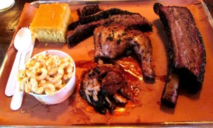 (L to R): brisket, jerk chicken, pulled pork, and beef rib with mac & cheese and cornbread