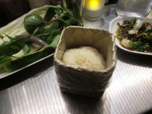 sticky rice with accompanying herbs & veggies (left) and laap meuang (right)