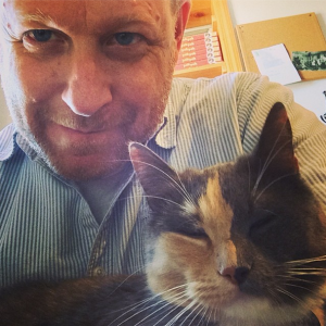 Andy Ricker with one of his cats (photo by Andy Ricker)