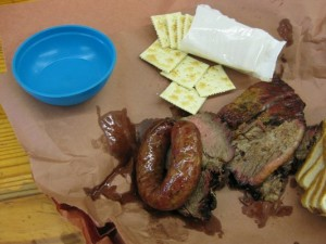 clockwise: saltines, brisket, slices of white bread, and sausage link