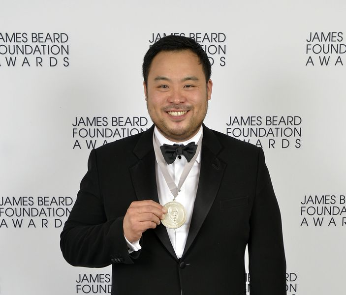David Chang posing with his James Beard Award medal (photo from andrewzimmern.com)