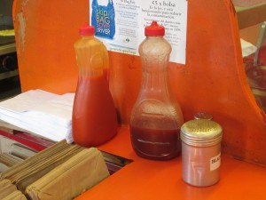 the mumbo sauce (middle) kept in repurposed syrup bottles at Smokey's