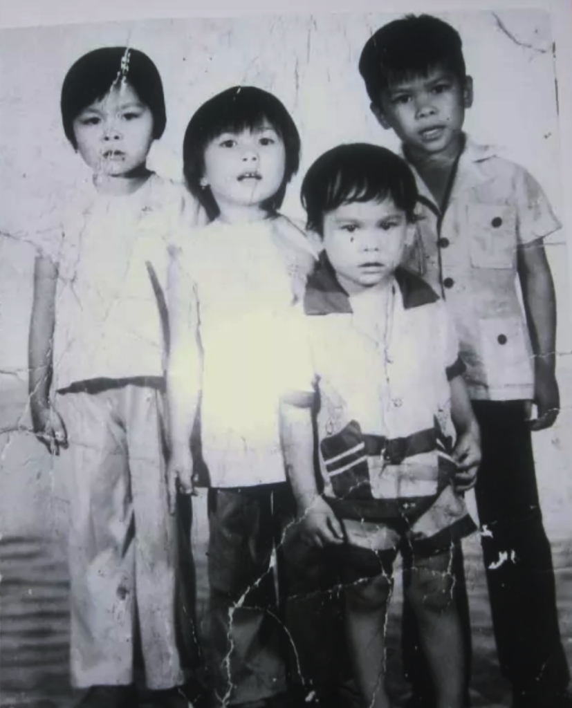Seng Luangrath (left) in Laos as a young girl with her siblings