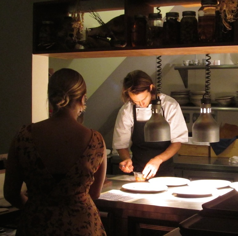 Fredrik Berselius plating one of his dishes at Aska